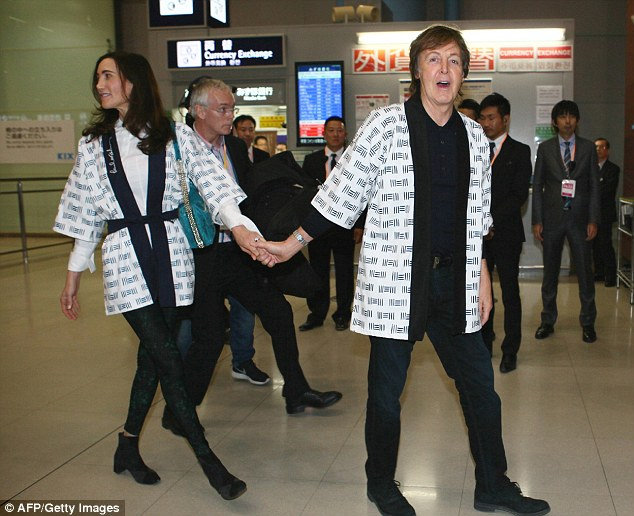 Sir Paul McCartney, accompanied by his wife Nancy, arrive at the Kansai International Airport in Osaka, Japan